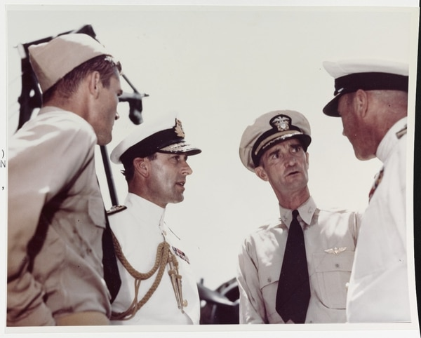 Admiral Lord Louis Mountbatten, Royal Navy, talks with officers on board the aircraft carrier Saratoga, at Colombo, Ceylon, in April 1944. Those present are (left-right): Lt. Cmdr. Robert Dose, USN; Adm. Mountbatten; Capt. John H. Cassady, USN; and British Rear Adm. Clement Moody. (National Archives)
