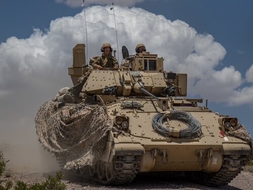Soldiers from 163rd Cavalry Regiment conduct a defensive attack exercise in their Bradley Fighting Vehicle at the National Training Center at Fort Irwin, Calif., June 1, 2019. (Cpl. Alisha Grezlik/Army)