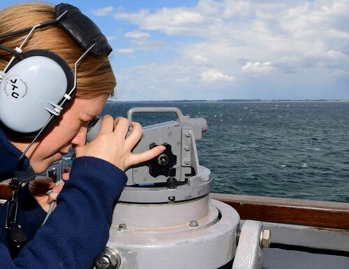 Quartermaster 3rd Class Annie Kilcrease uses an alidade aboard the guided-missile destroyer Ross in the Denmark Strait July 1, 2019. (MC2 Krystina Coffey/Navy)