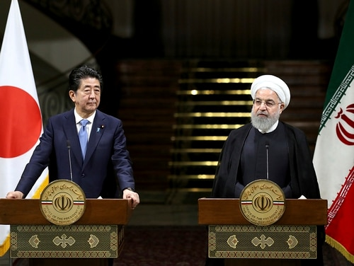 Iranian President Hassan Rouhani, right, speaks with media during a joint press conference with Japanese Prime Minister Shinzo Abe in Tehran, Iran, Wednesday, June 12, 2019. (Ebrahim Noroozi/AP)