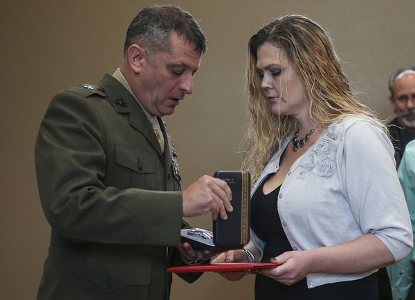 Tina Cline, wife of Lance Cpl. Donald J. Cline, receives her husband's posthumous Silver Star from Brig. Gen. Kurt W. Stein. (Lance Cpl. Ricardo R. Davila/Marine Corps)