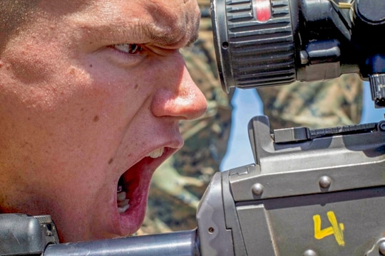 U.S. Marine Corps Lance Cpl. Christipher Watts, machine gunner, Battalion Landing Team 3/1, 13th Marine Expeditionary Unit (MEU), calls out a simulated misfire while aboard the Whidbey Island-class amphibious dock landing ship USS Rushmore (LSD 47) at sea, April 29, 2018. The Essex Amphibious Ready Group (ARG) and 13th MEU integrated to conduct the second major exercise of their pre-deployment training. ARG, MEU Exercise (ARGMEUEX) provides essential and realistic ship-to-shore training, designed to enhance the integration of the Navy-Marine Corps team. ARGMEUEX provides an opportunity to integrate unique individual and unit skills and develop the Essex ARG and 13th MEU's collective proficiency in challenging and unfamiliar environments. (Cpl. Danny Gonzalez/Marines)