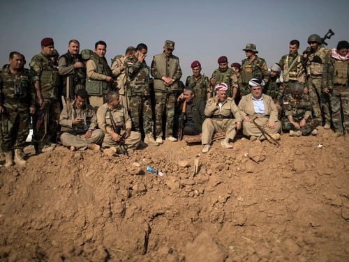 Kurdish peshmerga fighters and commanders overlook Islamic State group positions during heavy fighting in Bashiqa, east of Mosul, Iraq, in 2016. Kurds in the Mideast have repeatedly gotten close to setting up their own state or autonomous regions only to be abandoned by world powers. Now Syria's Kurds, who with U.S. backing have led the fight against the Islamic State group in that country, wait to see if the U.S. withdraws from Syria, leaving the Kurds to face Turkish forces. (Felipe Dana, AP)