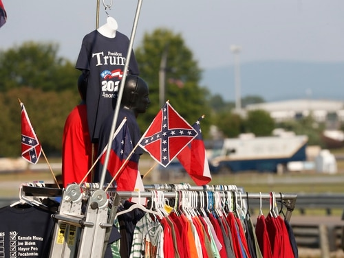 A vendor displays Confederate Battle flags as well as Trump 2020 flags across from the Speedway during the NASCAR Xfinity auto race at the Talladega Superspeedway in Alabama on June 20, 2020. (John Bazemore/AP)