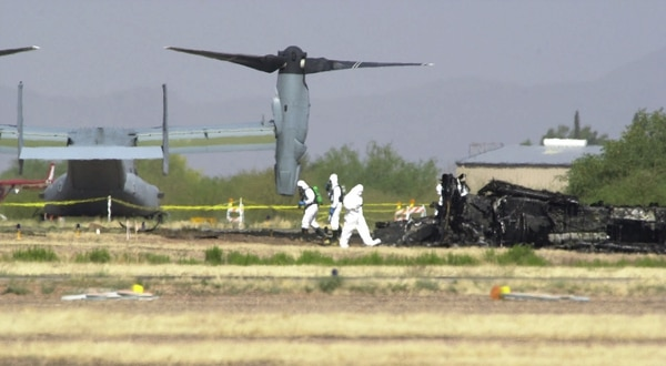 Workers investigate the crash scene of a Marine MV-22 Osprey north of Tucson, Ariz., on April 9, 2000. (Jon Hayt/Associated Press)