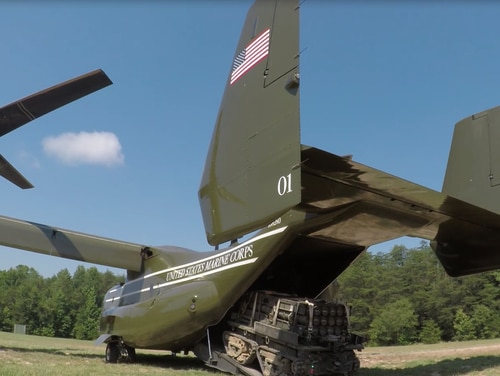 The eXpeditionary Robotic Platform, or XR-P, carries a load into an MV-22 Osprey.