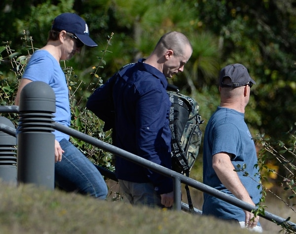 Bowe Bergdahl, center, demoted to private from sergeant, is escorted from the Fort Bragg military courthouse on Nov. 3, 2017, in Fort Bragg, N.C. Bergdahl was dishonorably discharged from the military after being charged with dissertation and misbehavior before the enemy in his deception to leave post in Afghanistan in 2009. (Sara D. Davis/Getty Images)