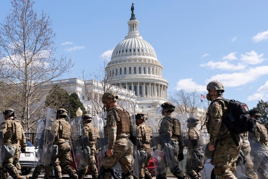Members of the National Guard leave the Capitol perimeter on April 2, 2021, after a car crashed into a barrier on Capitol Hill in Washington. After unprecedented mobilizations in 2020, the Guard's wish to grow its end strength is unlikely to be fulfilled. (Jacquelyn Martin/AP)