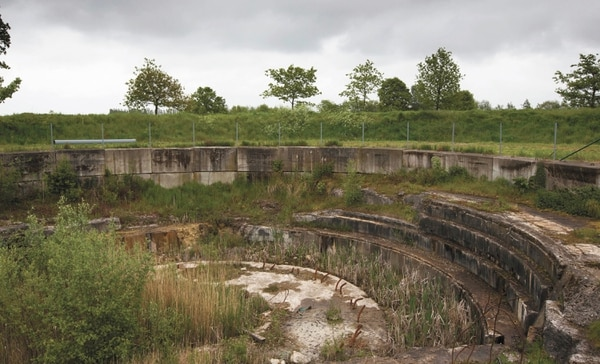 This photo taken on Thursday, May 8, 2014 shows the remains of the World War I German Lange Max gun in Koekelare, Belgium. The gun was originally designed to be a naval gun, but was later adapted as a railroad gun which was capable of long range. A century on, the four seasons bring constant changes to the scarred landscapes and ruins of the World War I battlefields in Belgium and northern France, yet many of the relics still exist, both above and below the surface. (AP Photo/Virginia Mayo)