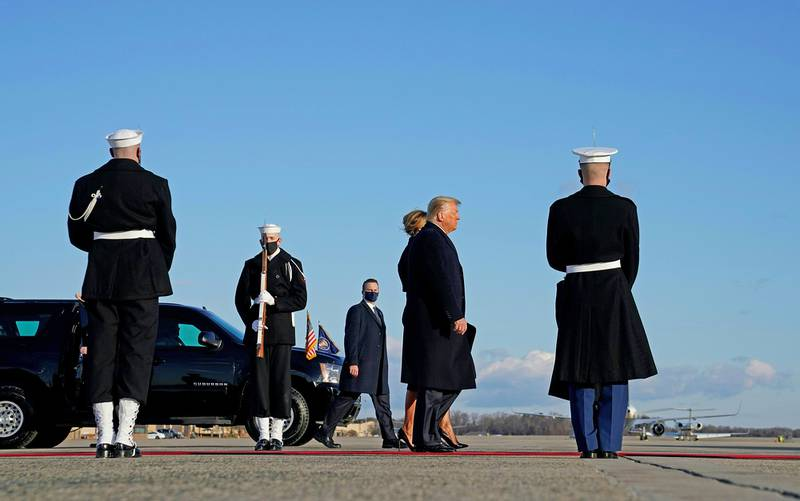 Outgoing President Donald Trump and first lady Melania Trump descend Marine One as they arrive at Joint Base Andrews in Maryland on Jan. 20, 2021.