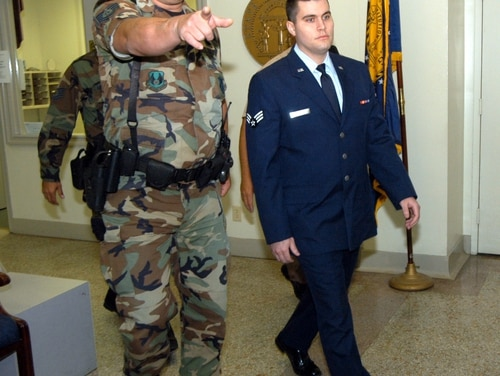 Senior Airman Andrew Paul Witt is escorted to the courtroom Tuesday, Sept. 13. U.S. Air Force photo by Sue Sapp