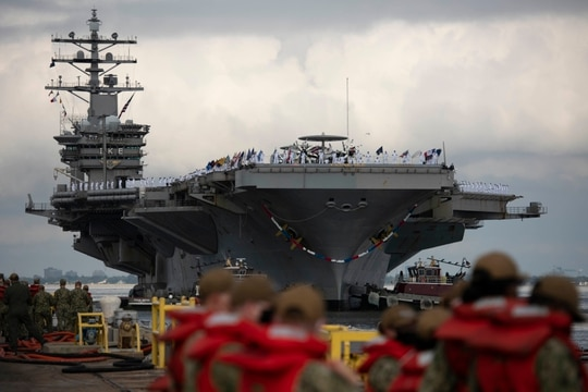 The carrier Dwight D. Eisenhower returns to Naval Station Norfolk after a Middle East deployment August 6. Ike is getting ready to leave early next year on another deployment. (U.S. Navy photo by MC1 Jason Pastrick)