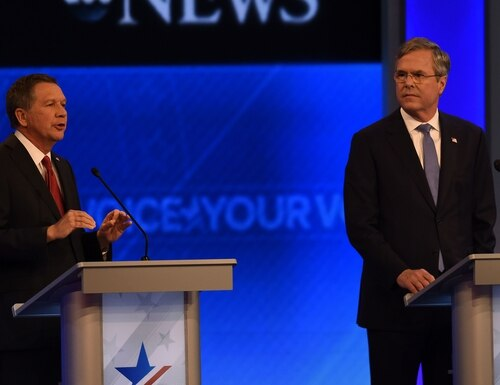 Republican presidential candidates John Kasich (L) and Jeb Bush participate in the Republican Presidential Candidates Debate on February 6, 2016 at St. Anselm's College Institute of Politics in Manchester, New Hampshire. Seven Republicans campaigning to be US president are in a fight for survival in their last debate Saturday before the New Hampshire primary, battling to win over a significant number of undecided voters. / AFP / Jewel Samad (Photo credit should read JEWEL SAMAD/AFP/Getty Images)