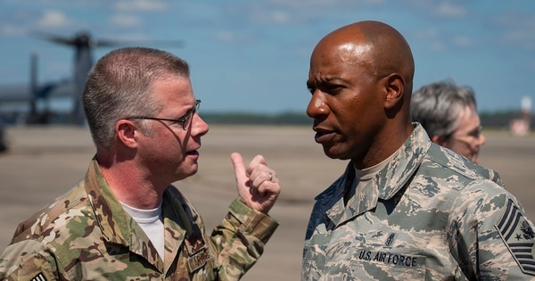 Chief Master Sgt. Greg Smith, left, command chief of Air Force Special Operations Command, speaks to Chief Master Sgt. of the Air Force Kaleth Wright at Hurlburt Field, Florida, Sunday. Aircrew members with the 8th Special Operations Squadron transported Air Force senior leaders from Hurlburt Field to Tyndall Air Force Base to assess the damage from Hurricane Michael. (Senior Airman Joseph Pick/Air Force)