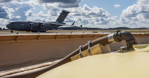 A C-17 Globemaster III taxis by as a Fuels Operation Readiness Capability Equipment system receives 8,000 gallons of fuel from a truck during Mobility Guardian 2019 at Fairchild Air Force Base, Washington, Sept. 11. It was the first time the mobile fuel bladders have been used stateside in an uncontested environment. (Tech. Sgt. Travis Edwards/Air Force)