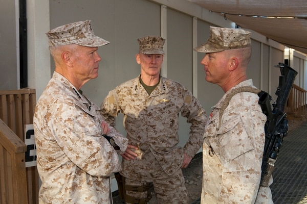 The 35th Commandant of the Marine Corps Gen. James F. Amos, left, and Lt. Gen. Richard T. Tryon, speak with Lt. Col. Christopher Dixon, commanding officer, 3rd Battalion, 2nd Marine Regiment, at Camp Leatherneck, Helmand province, Afghanistan, Sept. 22, 2011. General Amos, along with the Sergeant Major of the Marine Corps Sgt. Maj. Michael Barrett, traveled to Afghanistan to visit deployed service members throughout Regional Command (Southwest) and speak about recent events.