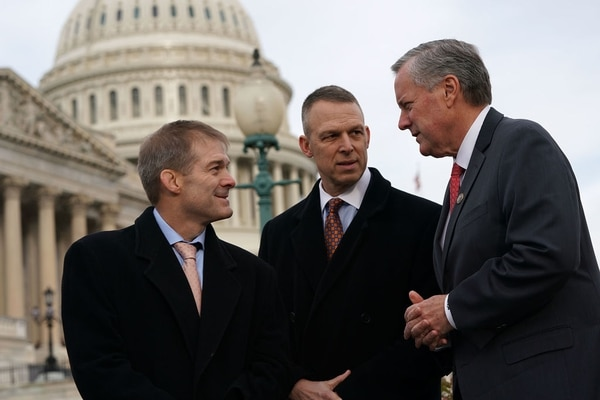 Rep. Mark Meadows, R-N.C., right, talks to Rep. Jim Jordan, R-Ohio, left, and Rep. Scott Perry, R-Pa., second from left, during a news conference in front of the Capitol on Dec. 6, 2017. (Alex Wong/Getty Images)