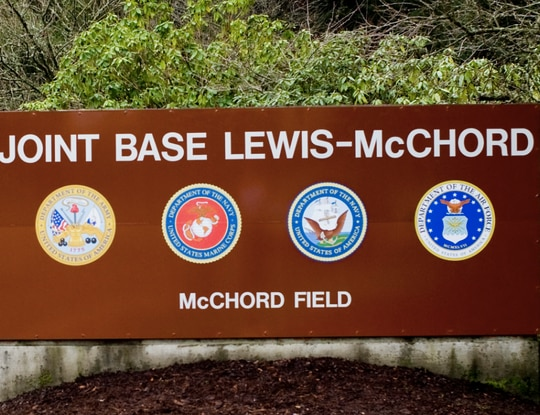 The Joint Base Lewis-McChord gate entrance pictured in 2010. (Abner Guzman/Air Force)