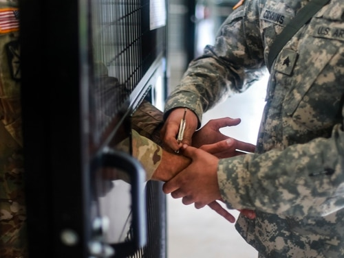 A former Fort Benning, Ga., soldier pleaded guilty Tuesday to one count of transportation of a minor with intent to engage in criminal sexual activity. Here, an Army Reserve MP handcuffs a mock detainee during a training exercise in 2017. (Spc. Therell Frett/Army)
