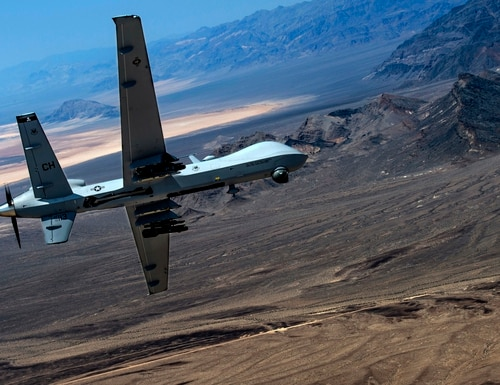 An MQ- Reaper remotely piloted aircraft performs aerial maneuvers over Creech Air Force Base, Nev., June 25, 2015. (Senior Airman Cory D. Payne/Air Force)