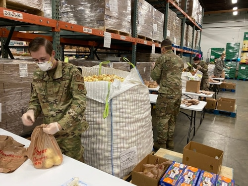 Airmen from the 141st Air Refueling Wing and the 242nd Combat Communications Squadron assist in packaging and distributing food at Second Harvest Inland Northwest on April 6,2020 in Spokane, Washington. The Guard remains under the control of the state governors, supporting communities and neighbors in a variety of ways - most importantly focused on supporting community-based testing sites, creating additional medical capacity, and providing logistical support to include transportation and distribution of medical supplies and food.