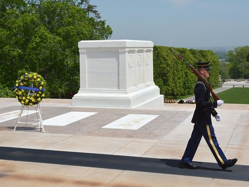 The Tomb of the Unknown Soldier at Arlington National Cemetery stands atop a hill overlooking Washington, D.C. On March 4, 1921, Congress approved the burial of an unidentified American soldier from World War I in the plaza of the Memorial Amphitheater.