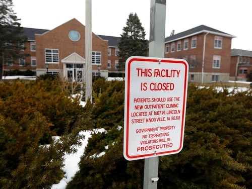 A facility closed sign hangs in front of the main building on the Veterans Affairs campus on March 12, 2019, in Knoxville, Iowa. The facility closed more than a decade ago. (Charlie Neibergall/AP)