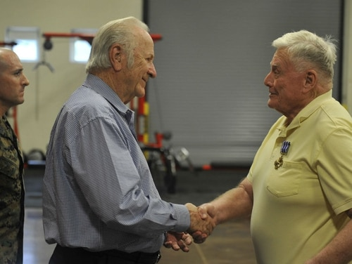 More than 52 years after a harrowing mission during the Vietnam War, retired Marine Corps aviator Lt. Col. John Jennings, right, finally received his Distinguished Flying Cross last month. It was presented by his friend, at left, retired Marine Corps Col. Haywood Smith. (Navy)