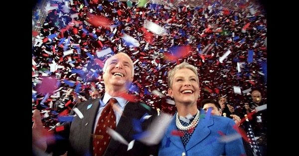 In this Jan. 30, 2000, file photo, confetti falls on Republican presidential hopeful Sen. John McCain, R-Ariz., and his wife, Cindy, at the end of their 114th New Hampshire town hall meeting with voters at the Peterborough Town House in Peterborough, N.H. (Stephan Savoia/AP)