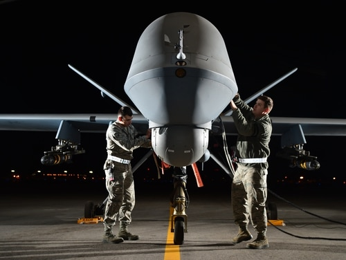 Airmen prepare an MQ-9 Reaper for flight during Combat Hammer May 15, 2014, Creech Air Force Base, Nev. (Staff Sgt. N.B./Air Force)