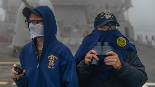 Logistics Specialist 3rd Class Tyler Stidham, left, and Logistics Specialist 3rd Class Rhandy Domigpe stand low-visibility watch aboard the Arleigh Burke-class guided-missile destroyer USS Russell (DDG 59) on May 15, 2020, in the East China Sea. (MC3 Sean Lynch/Navy)