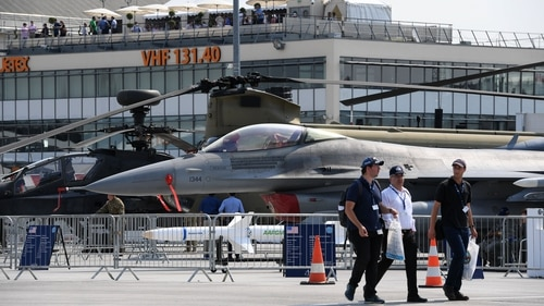 Visitors walk by U.S. equipment on display at the International Paris Air Show in Le Bourget outside Paris on June 21, 2017. (Christophe Archambault/AFP via Getty Images)