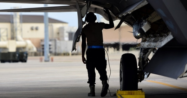 A maintainer with the 325th Maintenance Group inspects the underside of a 95th Fighter Squadron F-22 Raptor during a deployment exercise at Tyndall Air Force Base, Florida, June 14. (Airman 1st Class Isaiah J. Soliz/Air Force)