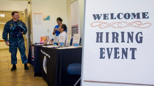 Service members attend a job fair at Joint Base Pearl Harbor-Hickam. (Mass Communications Specialist 3rd Class Justin Pacheco/Navy)