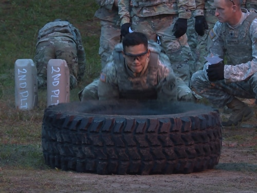 A soldier from the 264th Engineer Company at Fort Bragg, N.C., prepares to flip a tire as part of a recent trial of the new Soldier Readiness Test. The test, developed by Army Forces Command, is being tested and is pending final approval from Army leaders. (Daniel Woolfolk/Staff)