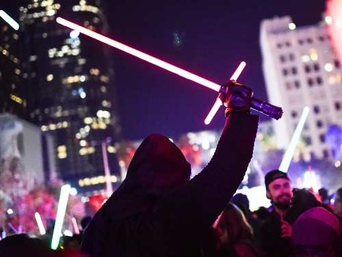 A Star Wars fan dressed as Kylo Ren raises his lightsaber during Lightsaber Battle LA in Pershing Square in downtown Los Angeles, Calif. (Robyn Beck/AFP via Getty Images)