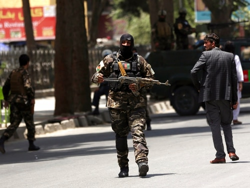 Security personnel patrol near a park where a would-be attacker was killed in Kabul, Afghanistan, Monday, July 16, 2018. (Massoud Hossaini/AP)