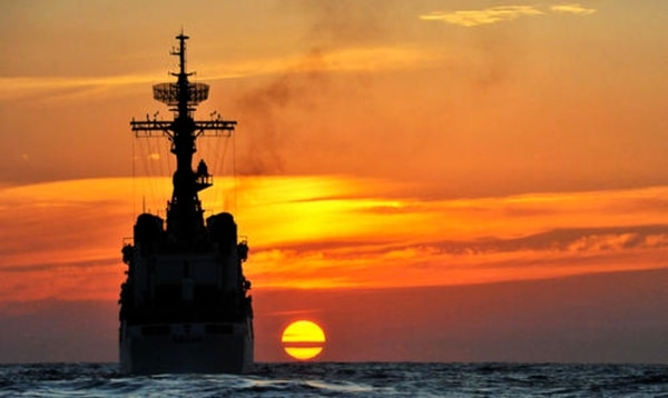 The Coast Guard cutter Dallas sailed into the setting sun on Feb. 14, 2012. The ship was on its last patrol before it was decommissioned. (Coast Guard)