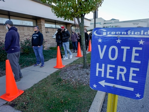People line up to vote outside the Greenfield Community Center on Election Day (Nov. 3, 2020) in Wisconsin. (Morry Gash/AP)