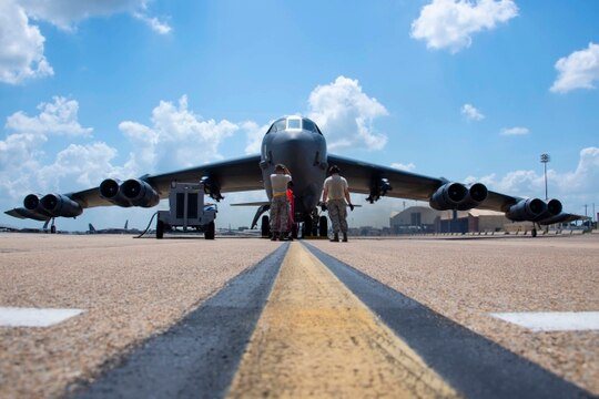 Crew chiefs from the 11th Aircraft Maintenance Unit run final checks on a B-52 Stratofortress prior to take-off from Barksdale Air Force Base, Louisiana, Aug. 21. The jet was being prepared to attempt the first-ever launch of laser-guided bombs from a Conventional Rotary Launcher. (Master Sgt. Ted Daigle/U.S. Air Force)