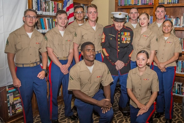 Marines stationed at Marine Corps Base Camp Pendleton pose with retired 1st Sgt. John Farritor as part of his 100th birthday celebration at the Pacifica Senior Living Center in Vista, California, July 9. (Lance Cpl. Drake Nickels/Marine Corps)