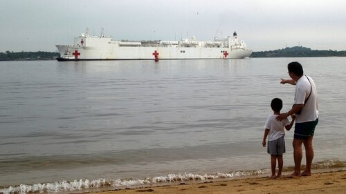 The Navy has proposed retiring one of its two hospital ships, which provide humanitarian relief around the world. Above, the USNS Mercy crosses the Johor Strait between Singapore and Malaysia in 2005 to support Operation Unified Assistance, the humanitarian effort in the wake of the tsunami that struck Southeast Asia. (Lt. Chuck Bell/Navy)
