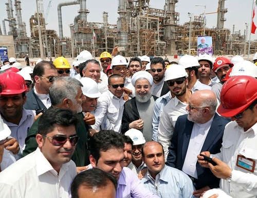 In this April 30, 2017, file photo, released by an official website of the office of the Iranian Presidency, Iranian President Hassan Rouhani, center, inaugurates the Persian Gulf Star Refinery in Bandar Abbas, Iran. (Iranian Presidency Office via AP, File)