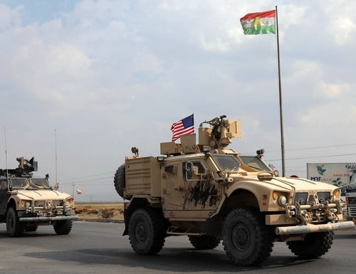A convoy of U.S. military vehicles arrives near the Iraqi Kurdish town of Bardarash Oct. 21 after withdrawing from northern Syria. (Safin Hamed/AFP via Getty Images)
