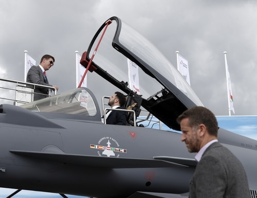 A man sits in the cockpit of a Eurofighter Typhoon aircraft during the Farnborough Airshow on July 18, 2018. The jets are slated for a radar upgrade that will see Britain split from other Eurofighter user nations. (Adrian Dennis/AFP via Getty Images)