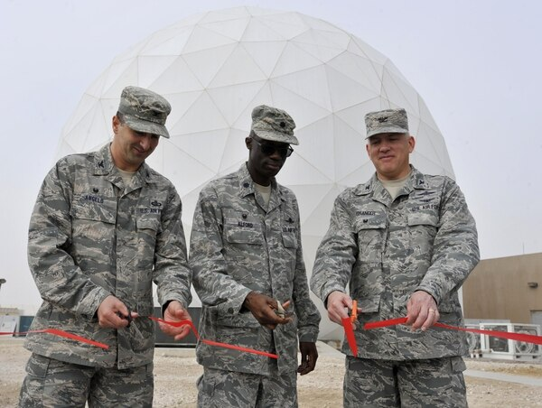 Col. Thomas Angelo, 379th Expeditionary Mission Support Group commander, Lt. Col. Carlos Alford, 379th Expeditionary Communications Squadron commander, and Col. Jeffrey Granger, United States Air Forces Central Command Forward Director of Cyber Forces, cut a ribbon signifying completion of the Modernized Enterprise Terminal at Al Udeid Air Base, Qatar, Jan. 21, 2016.The 379 ECS recently completed an upgrade to their Army, Navy Ground Satellite Communications system which will enable better communications for warfighters. (U.S. Air Force photo by Master Sgt. Joshua Strang)