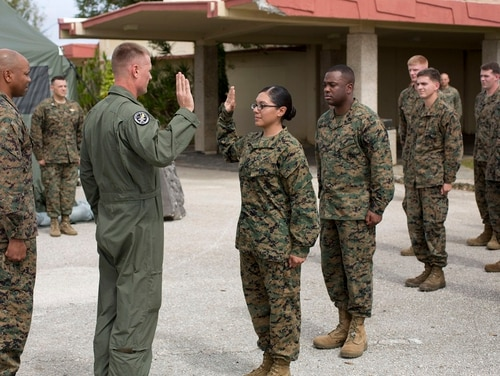 Lance Cpl. Remedios Cruz, Marine Aircraft Group 12, recites the Oath of Enlistment after being meritoriously promoted at Anderson AFB, Guam, Dec. 4, 2013. (Lance Cpl. Richard Currier/Marine Corps)