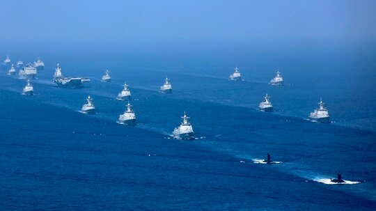 The Liaoning aircraft carrier is accompanied by frigates and submarines on April 12, 2018, conducting exercises in the South China Sea. (Li Gang/Xinhua via AP)