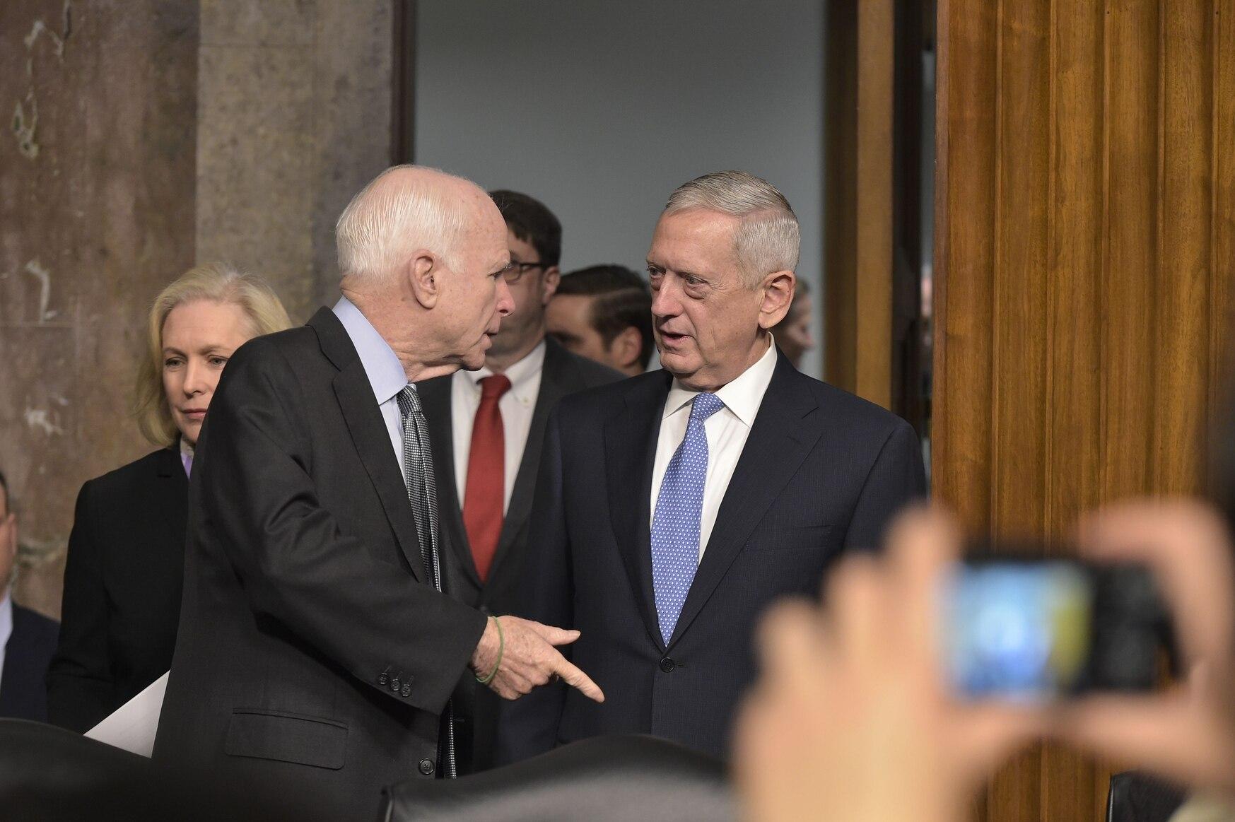 FILE- In this Jan. 12, 2017 file photo, retired Marine Corps general James Mattis speaks to Sen. John McCain (L),R-Ariz., before he testifies before the Senate Armed Services Committee. (Mandel Ngan/AFP/Getty Images)