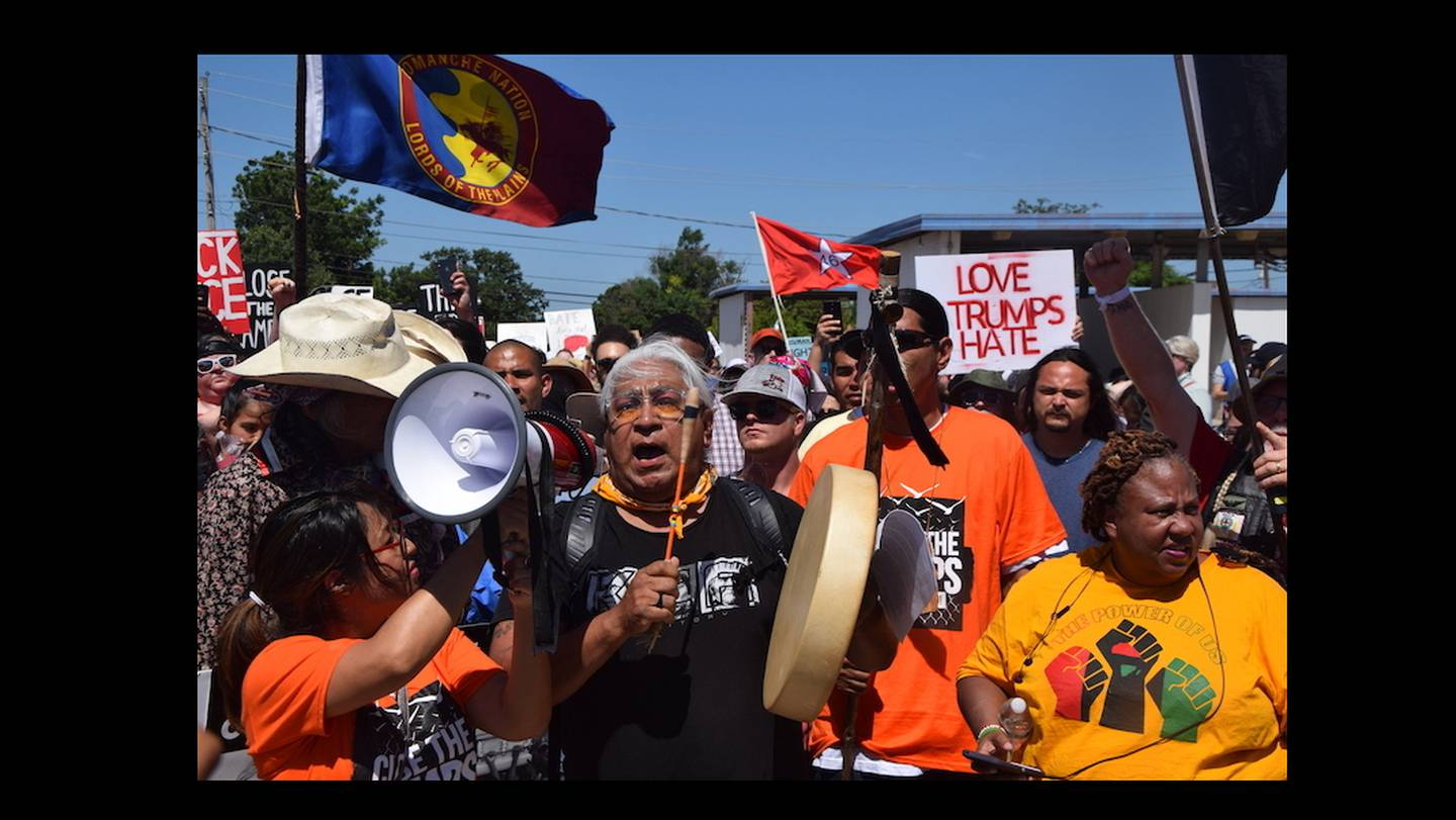 Dr. Cornel Pewewardy beats the drum and leads  protesters as they march along Northwest Ozmun Avenue and onto Sheridan Road to the Fort Sill entry gates, Saturday, July 20, 2019 in Lawton, Okla